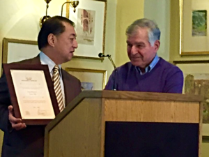 Tsutomu Himeno, Consul General of japan receives award from Gov. Michael Dukakis, ©2015 dick pirozzolo